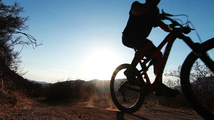 Silhouette of Man Mountain Biking At Sunset In Mountains HD