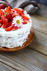 cake with ripe strawberries and cream