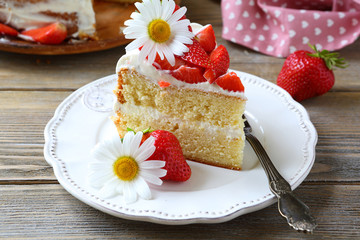 piece of delicious cake with strawberries and cream