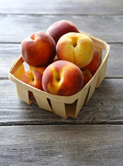 tasty peach in wooden box