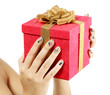 Female hands with big gift box