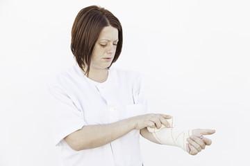 Girl bandaged arm