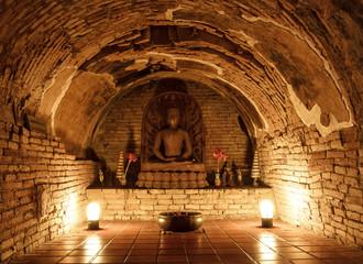 Statue of Buddha in underground temple Wat Umong, Chiang Mai