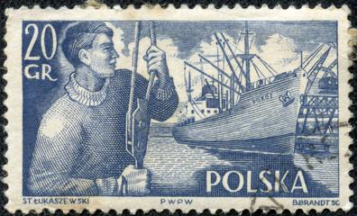 sailor with a cargo pulley over the Polish cargo ship
