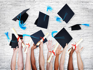 Group Of Hands Holding Diplomas And Throwing Mortar Board