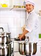 Man in chef hat cooking chicken