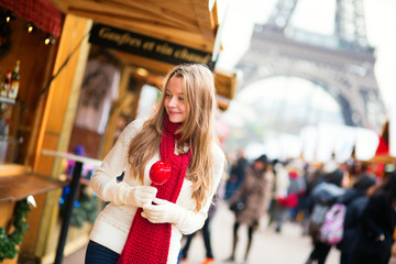 Happy girl on a Parisian Christmas market