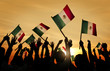 Silhouettes of People Holding Flag of Mexico - 69873137