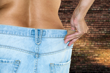 Woman with jeans topless making diet
