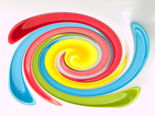 Light blue, green, yellow and pink twirling abstract background