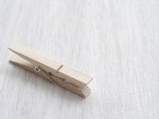 Wooden Cloth Pegs on wood Background