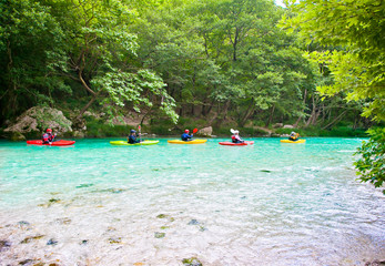 Group traveling by kayak on  Acheron river in Greece.