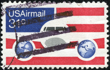 Plane and Globes on red white and blue background
