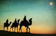 canvas print picture - Group of People Riding Camel Isolated on Background