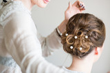 Fototapety Bride getting her hair done before wedding