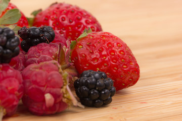 Mix of berries on a wooden table