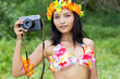hawaii hula dancer holding camera