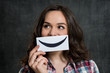 Woman Holding Smiley Emoticon