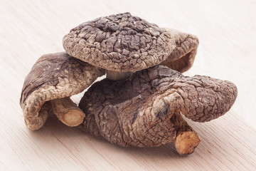 dried shiitake mushrooms on wooden table