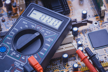 Close-up of multimeter on PCB plate