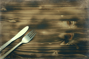 Knife and fork set on a wooden vintage table