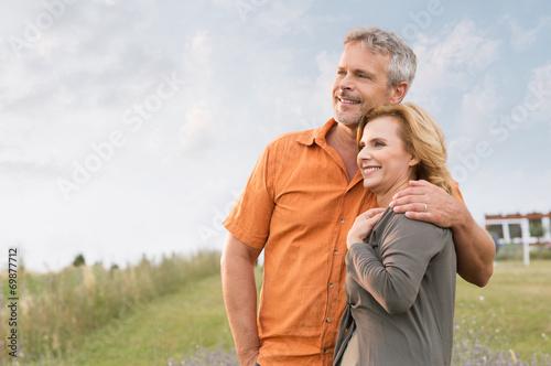 Leinwanddruck Bild Mature Couple Daydreaming