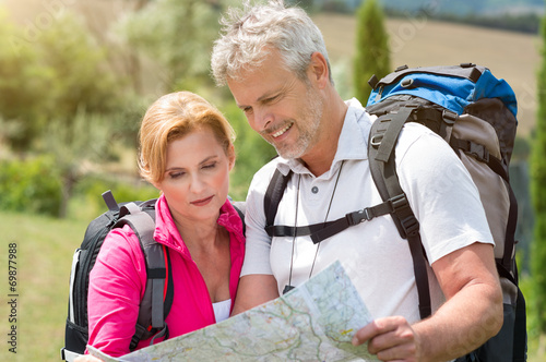 canvas print picture Mature Hiker Looking At Map