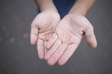 Child's hands outside