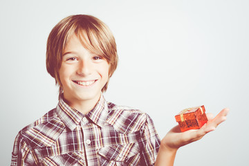 child with little red gift box
