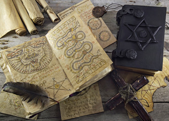 Still life with magic objects and books