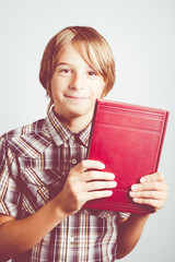 child with book in the hands