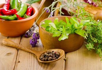 Fresh herbs on a wooden background