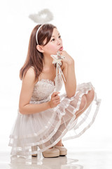 Beautiful Asian Woman in Angel Costume, sitting looking up
