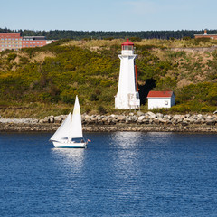 White Sailboat and Lighthouse