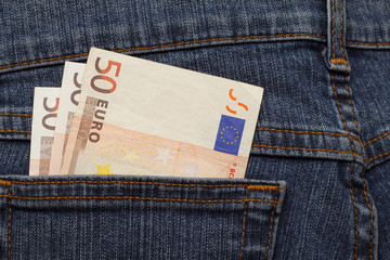 three banknotes of 50 euro in jeans pocket