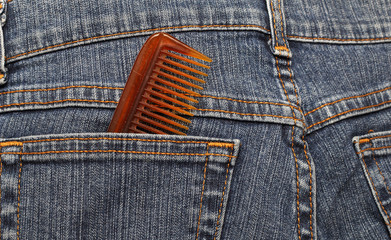 hairbrush the hair in the back pocket of jeans