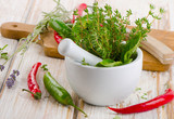 Mortar with  herbs and chili