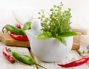 Fresh herbs and chili peppers