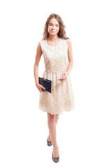 Female model wearing lace dress.