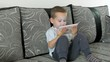 little boy watching cartoon or movie on touch