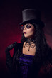 Vampire gothic girl in tophat and round eyeglasses