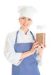 Portrait of happy female chef cook with buckwheat.