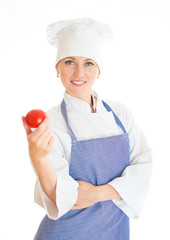 Portrait of happy female chef cook with tomato.