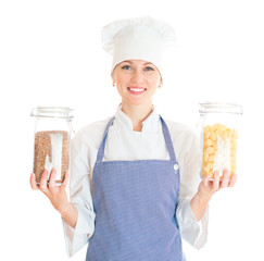 Portrait of female chef cook with pasta and buckwheat.