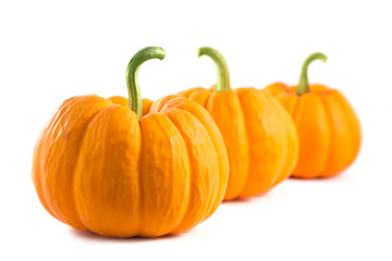 Row of fresh orange pumpkins
