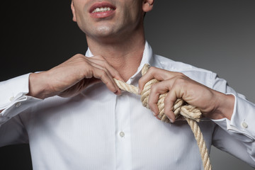 Taking the rope off neck