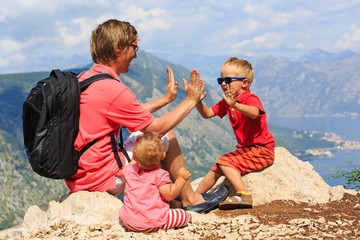 family having fun on vacation in mountains