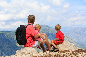 father and kids looking at mountains on vacation