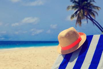 hat on tropical sand beach