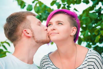Close up of a young couple kissing